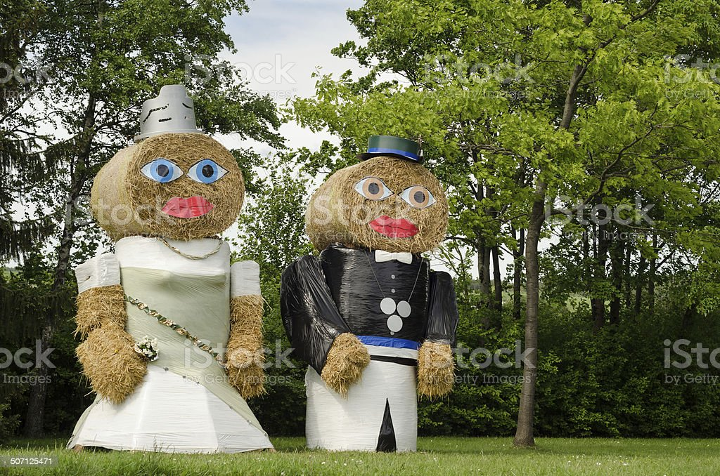coupl, king and queen made of straw stock photo