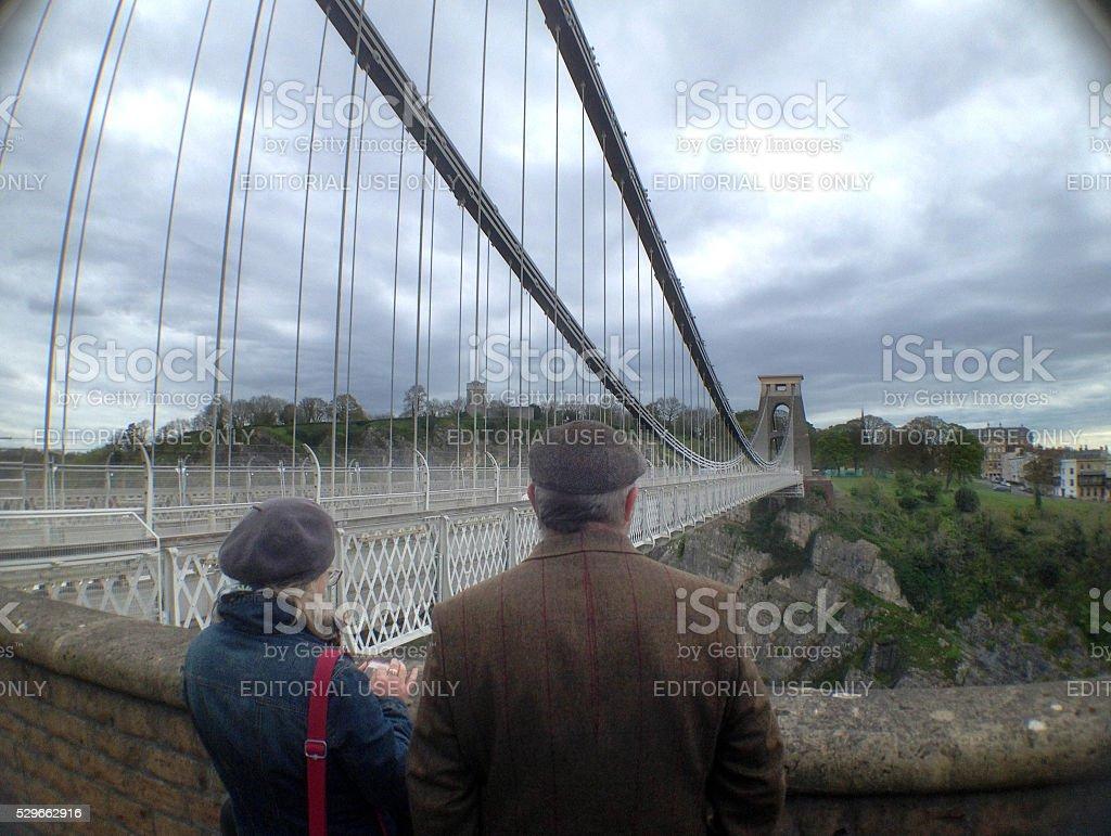Couple admiring Clifton Suspension Bridge, Bristol, England stock photo