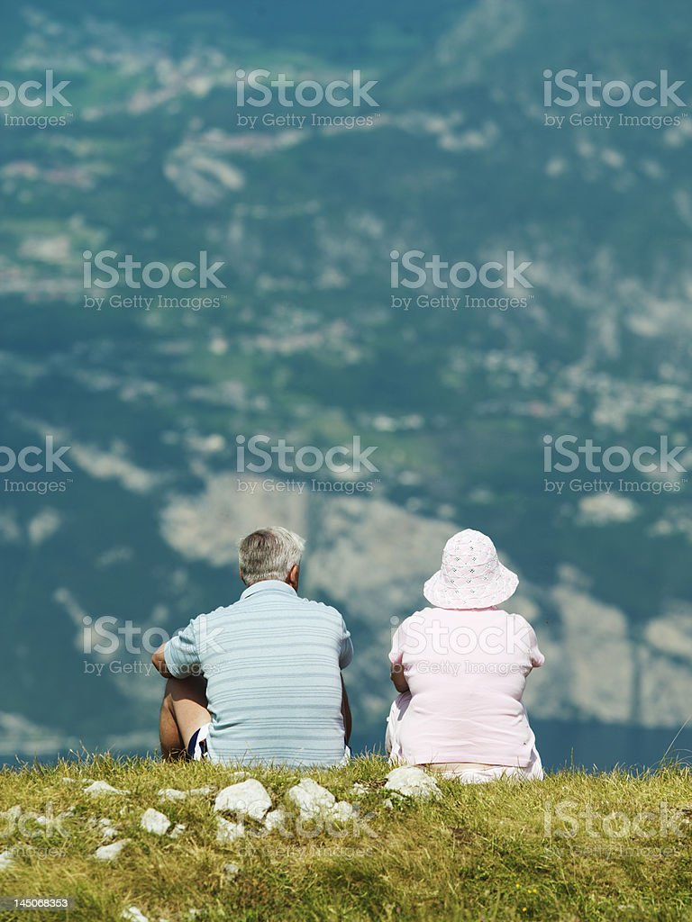 Couple admiring rural hillside view stock photo