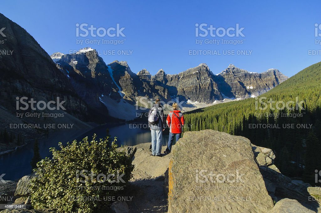 Couple admiring the natural beauty of Moraine Lake royalty-free stock photo