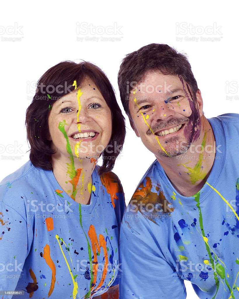 Couple after a family paint war party royalty-free stock photo