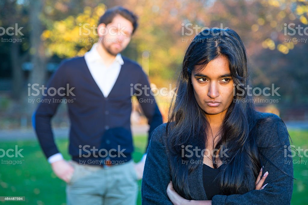 Couple after a fight outside in park stock photo