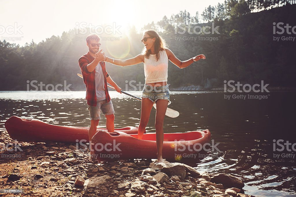 Couple after kayaking in the lake stock photo