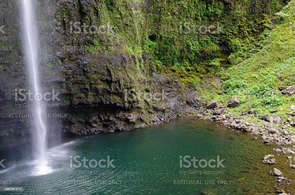 Couple after swimming at Hanakapi'ai Falls on Kauai, Hawaii stock photo