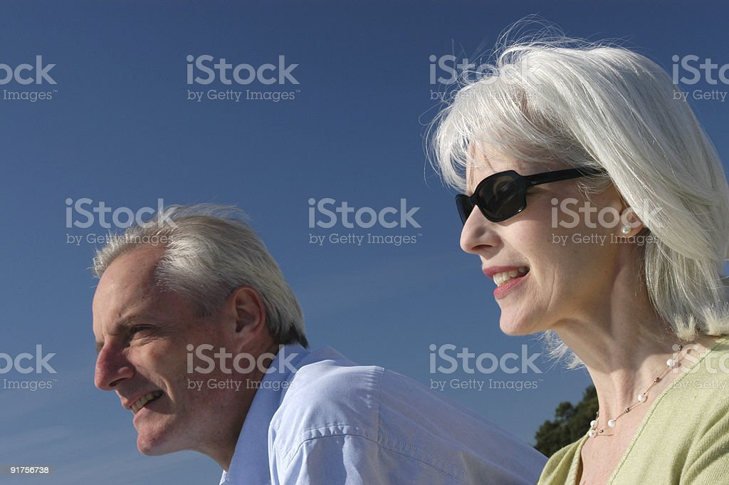 couple aged 50 looking out of shot royalty-free stock photo