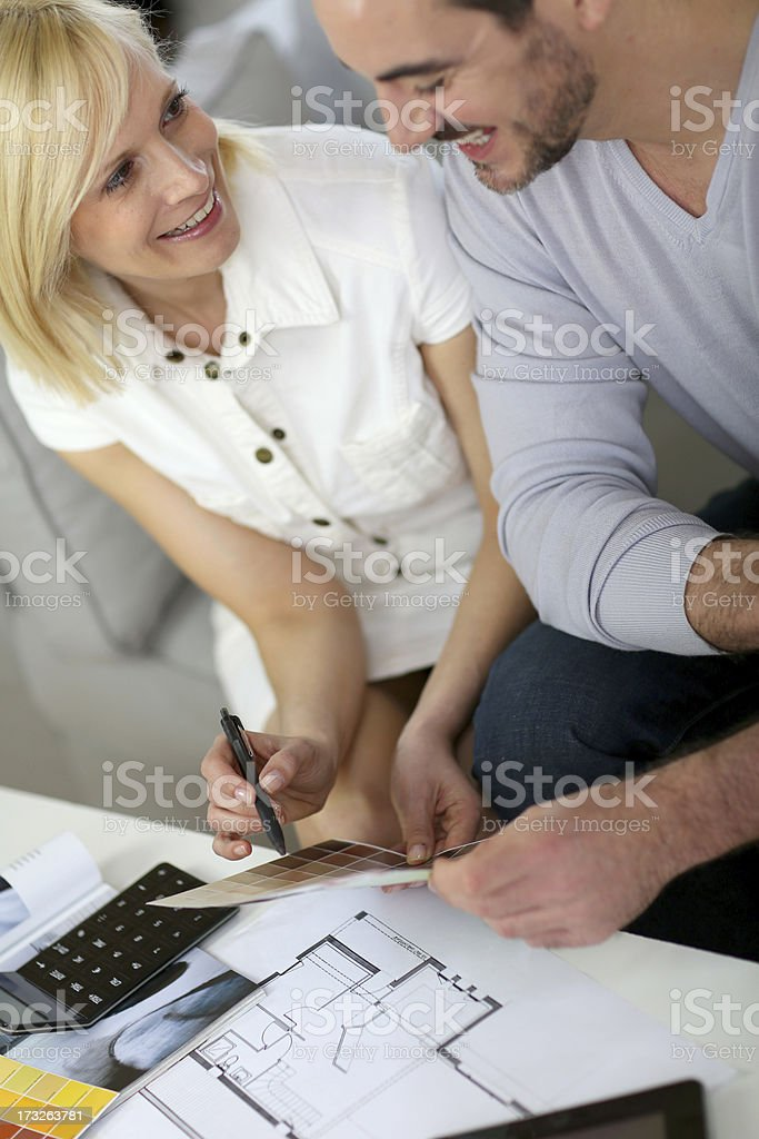 Couple agreeing on the choice of color royalty-free stock photo