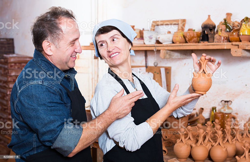 Couple among the pottery stock photo