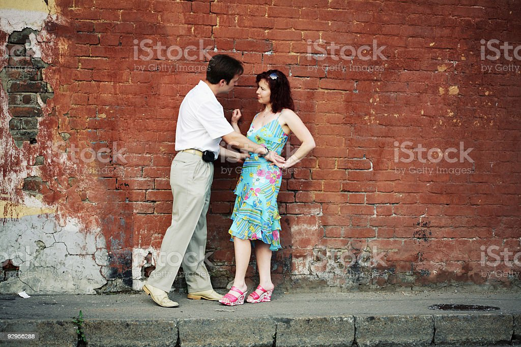 couple and brick wall royalty-free stock photo