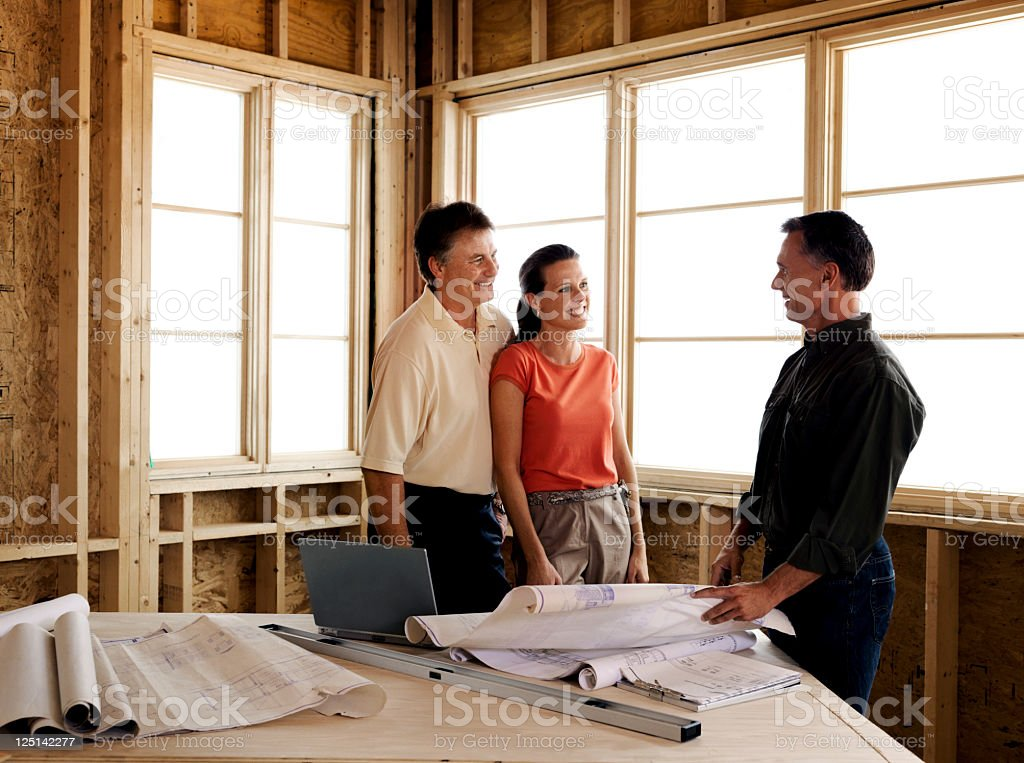 Couple and Builder stock photo