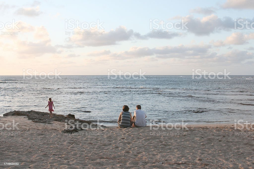 Couple and child on the beach royalty-free stock photo
