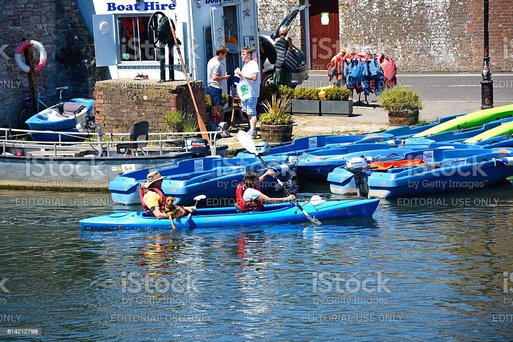 Couple and dog in a canoe, Wareham. stock photo
