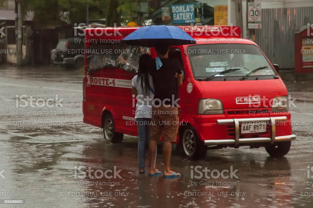 Couple and Jeepney in the road stock photo