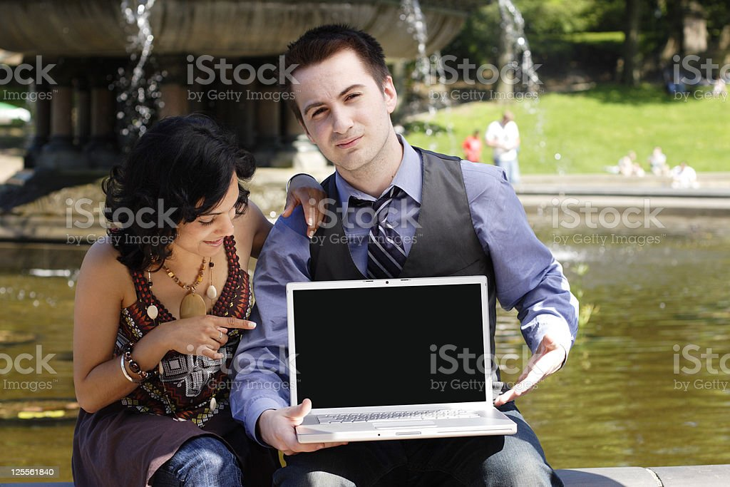 Couple and Laptop Screen stock photo