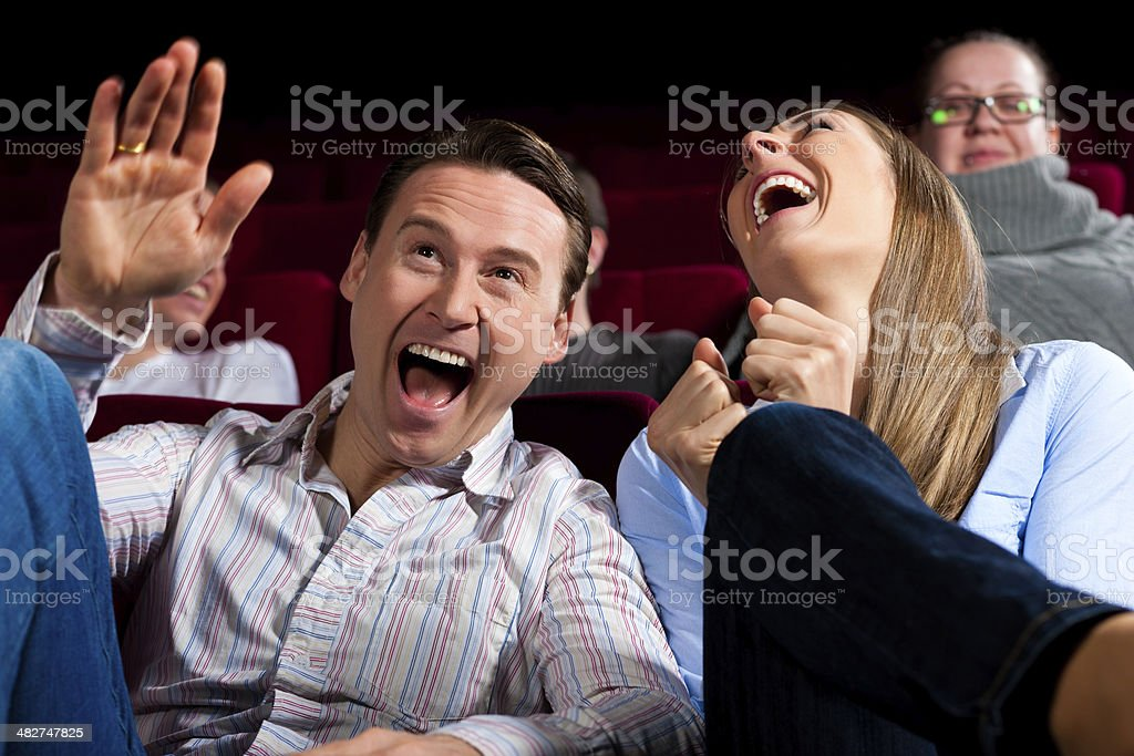 Couple and other people in cinema stock photo