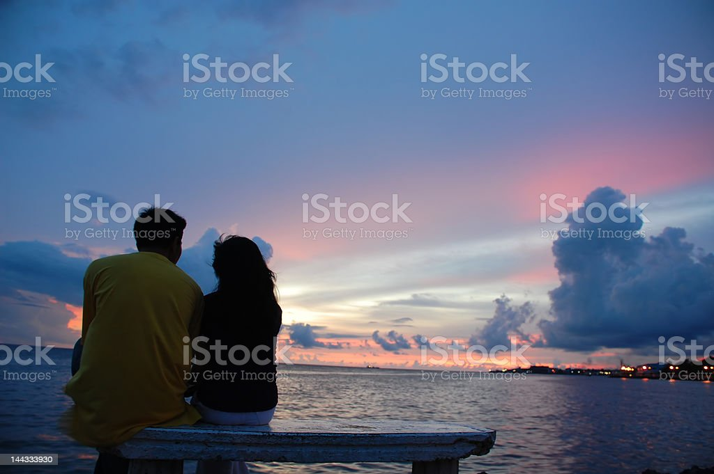 couple and the sunset stock photo