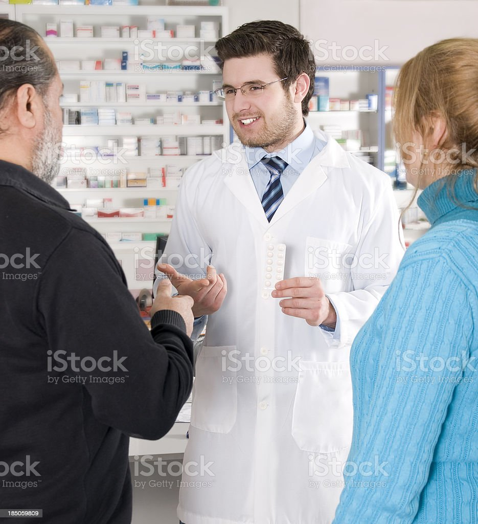 couple are talking with pharmacist royalty-free stock photo