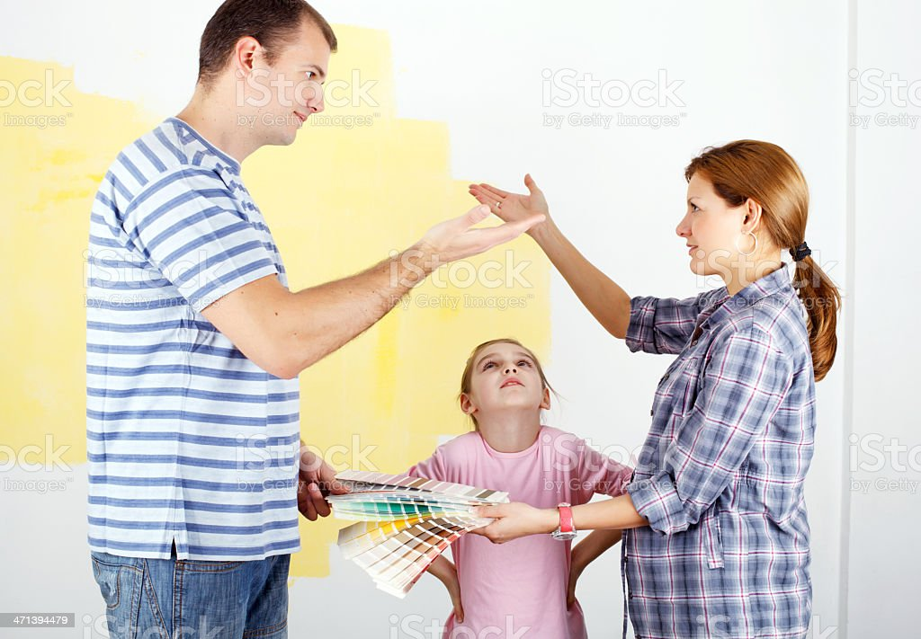 Couple arguing about the color for painting their home royalty-free stock photo