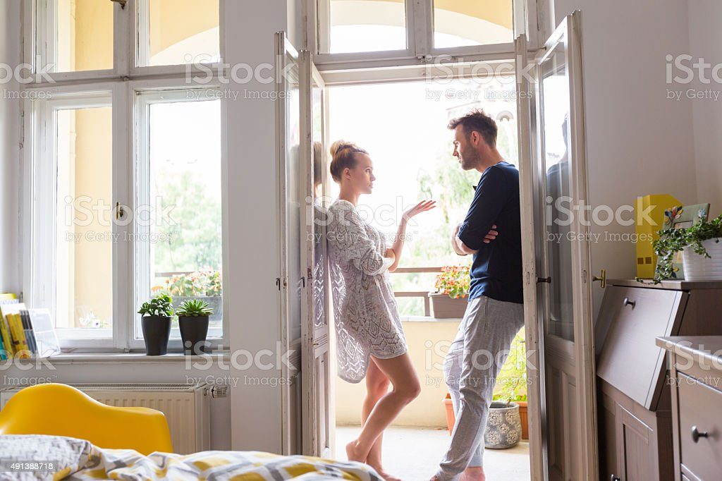 Couple arguing in the morning at home stock photo