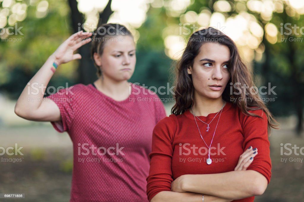 Couple arguing in the park stock photo