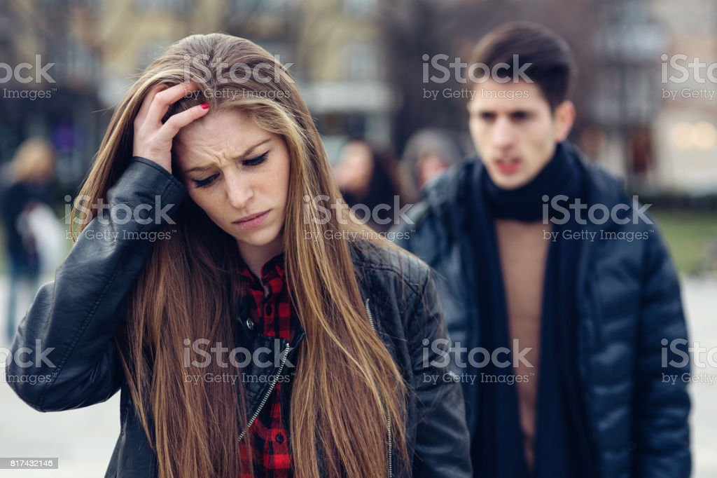 Couple arguing on the street stock photo