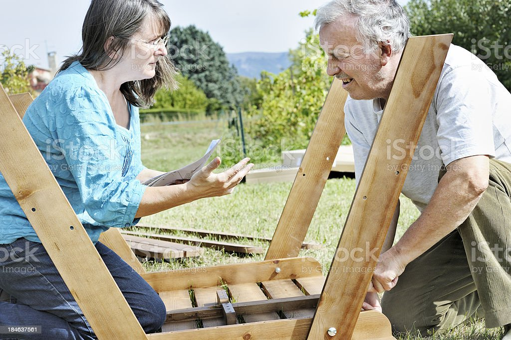 Couple arguing over assembling table royalty-free stock photo