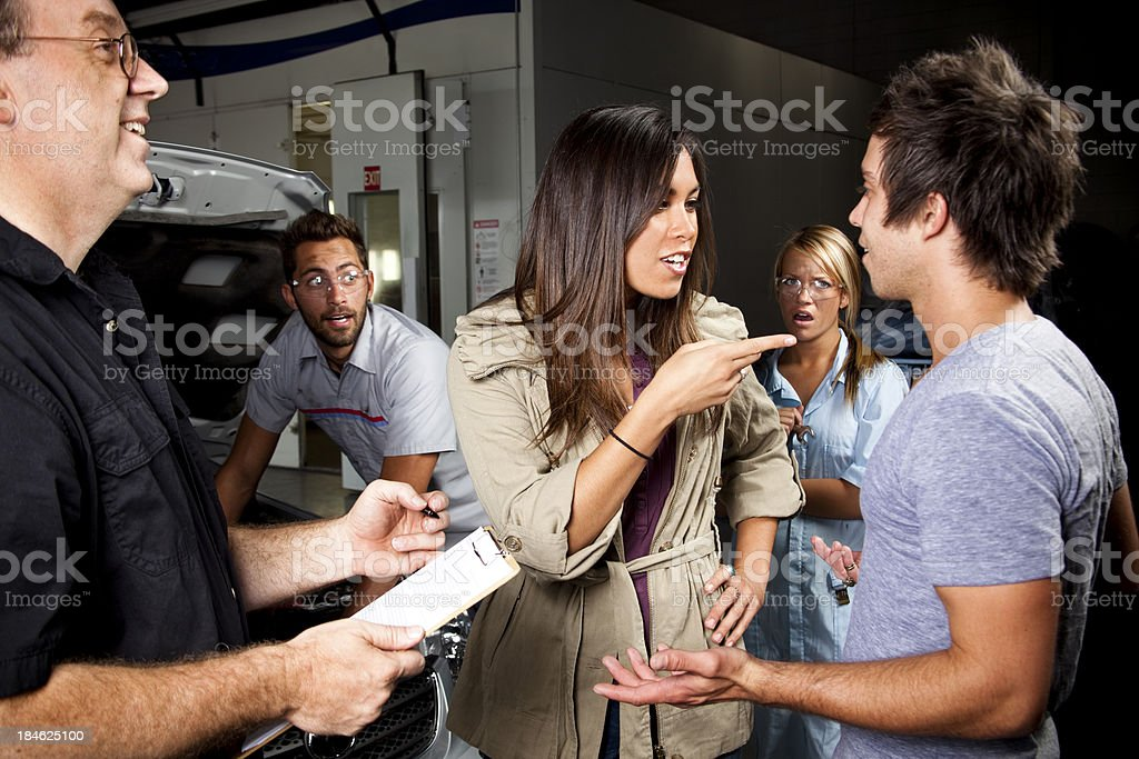 Couple arguing over vehicle repairs royalty-free stock photo