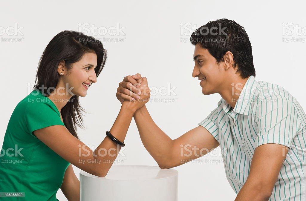 Couple arm wrestling stock photo