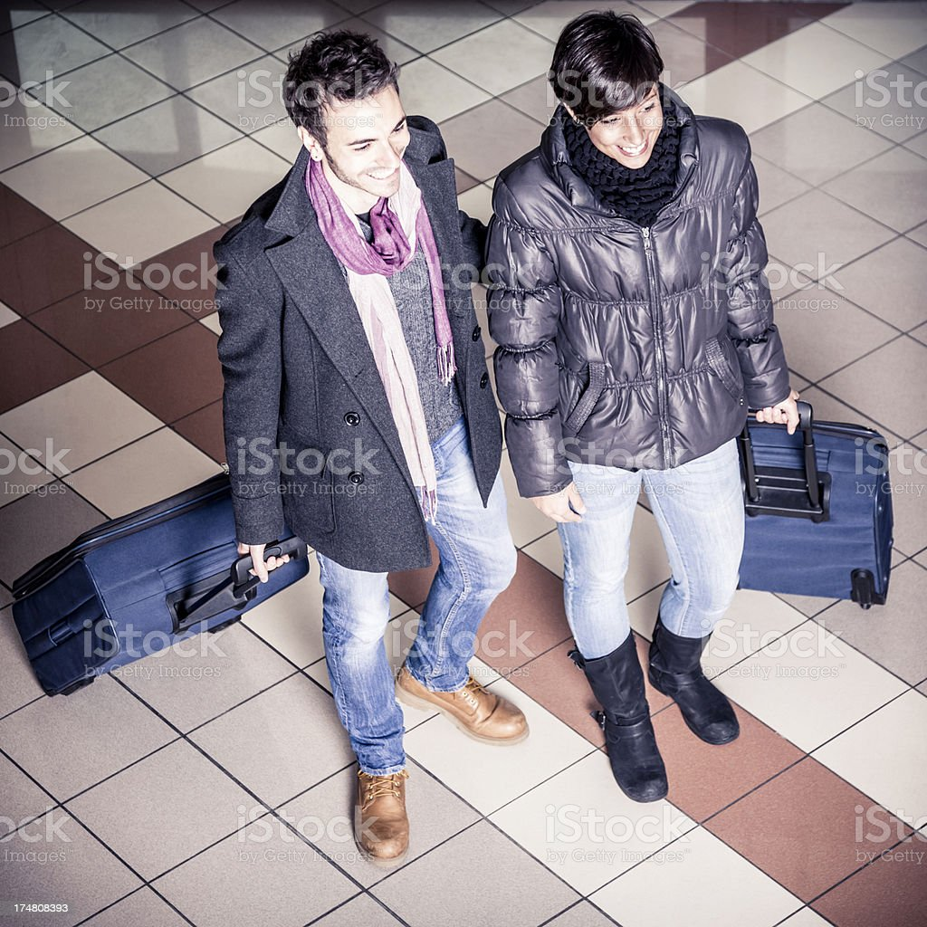 Couple arriving at the hotel royalty-free stock photo