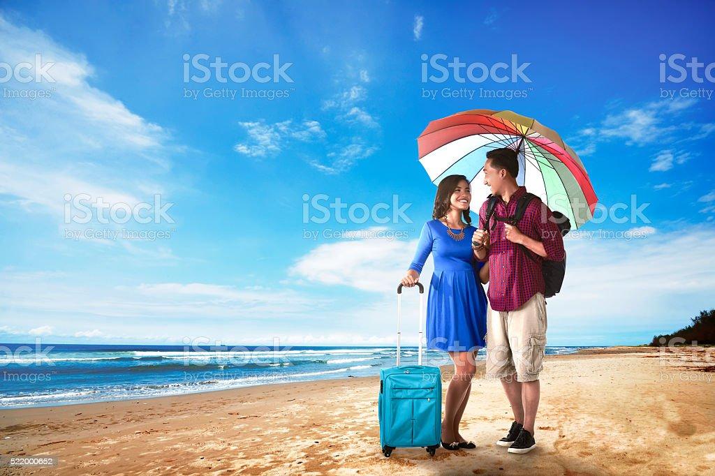 Couple asian tourist standing on the beach stock photo