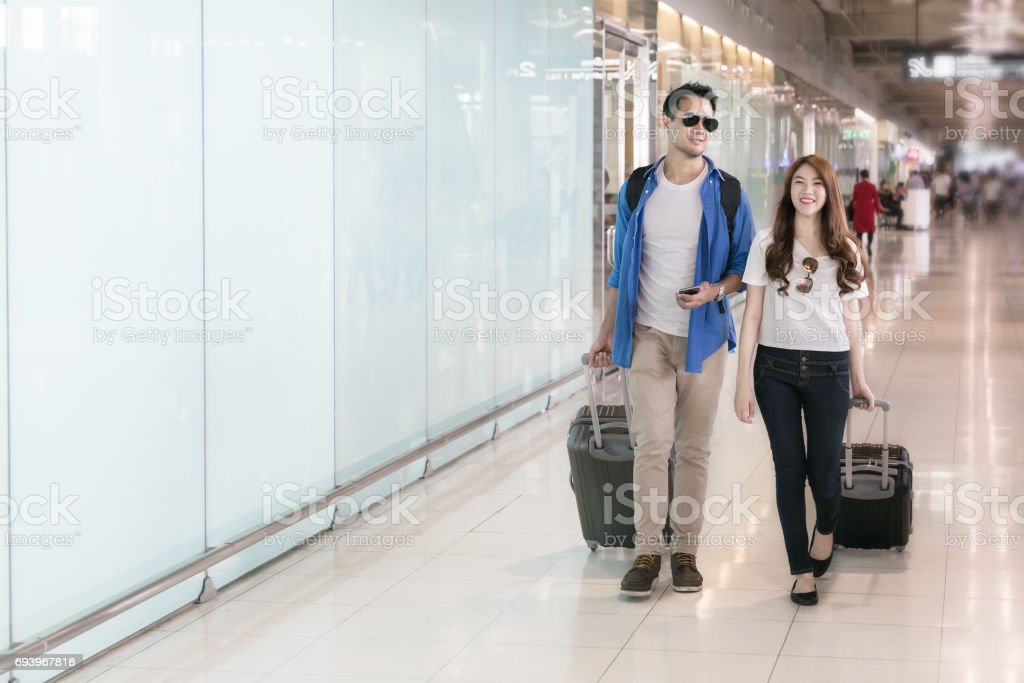 Couple asian traveler in happy moment with baggage at airport terminal. Travel summer concept. stock photo