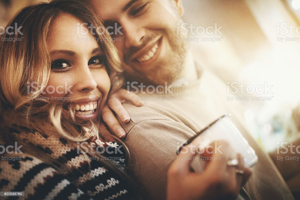 Couple at a coffee place on winter night. stock photo