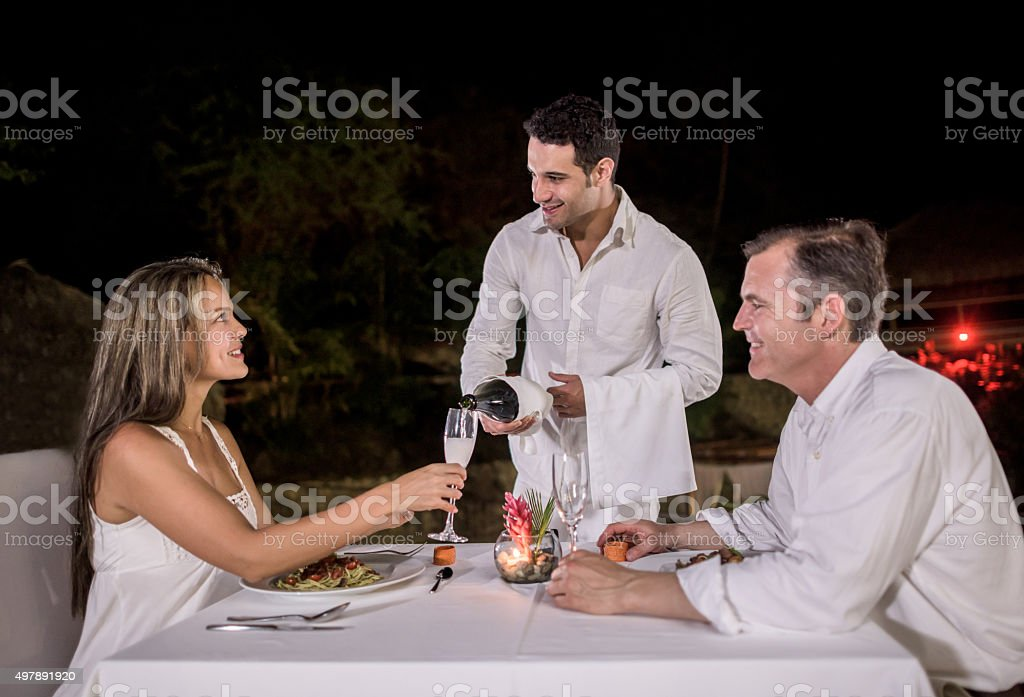 Couple at a romantic dinner stock photo