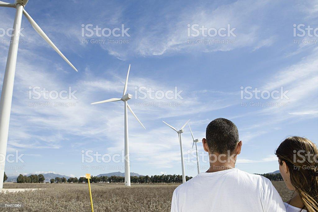 Couple at a wind farm stock photo