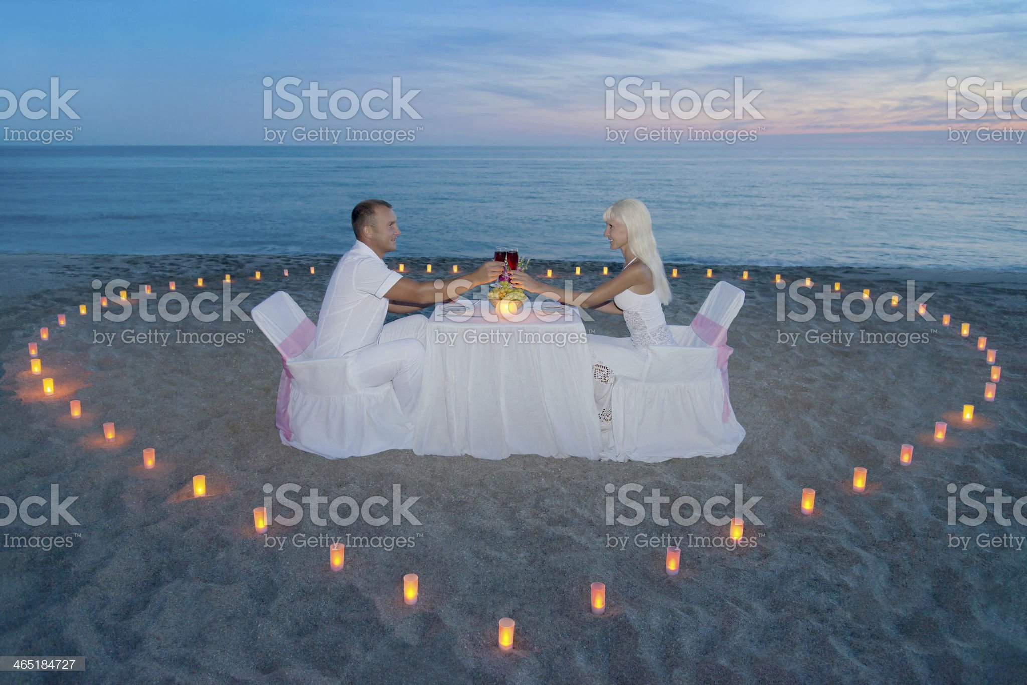 couple at beach romantic dinner with candles heart royalty-free stock photo
