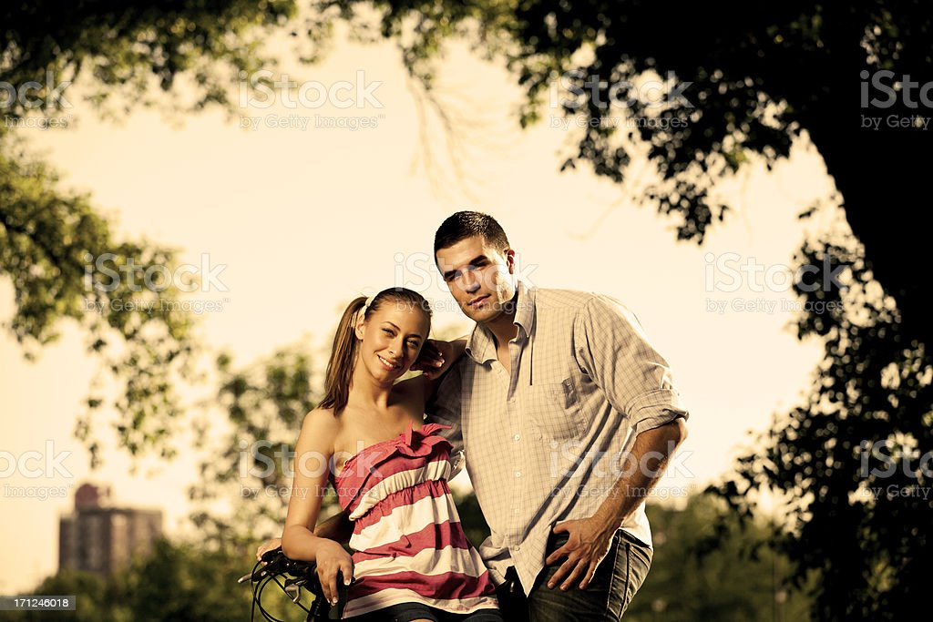 Couple at bike royalty-free stock photo