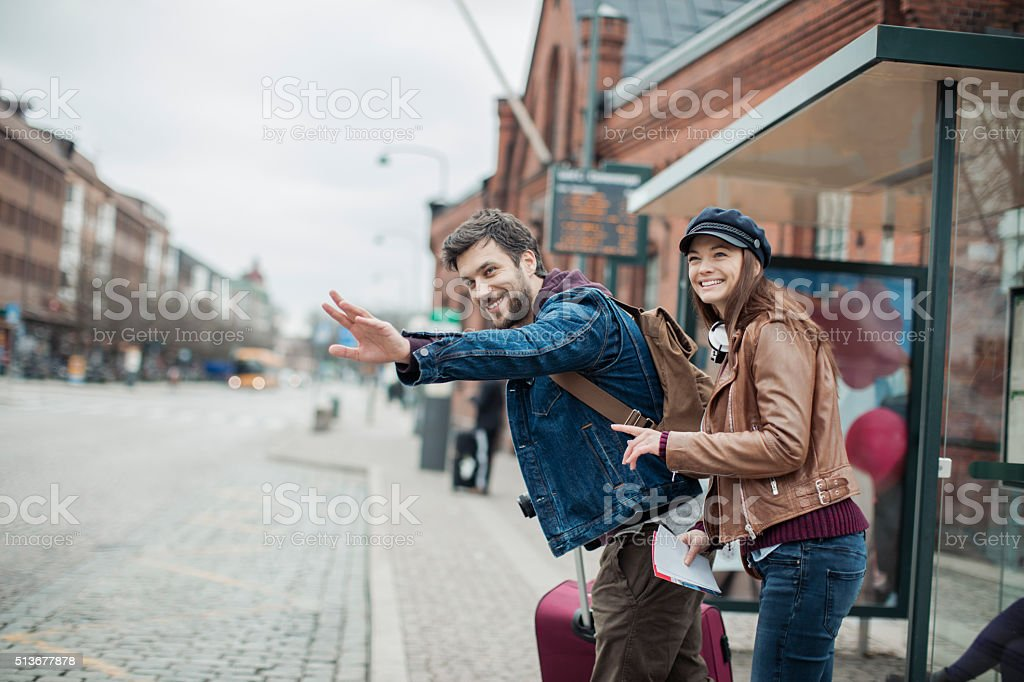 Couple at bus station stock photo