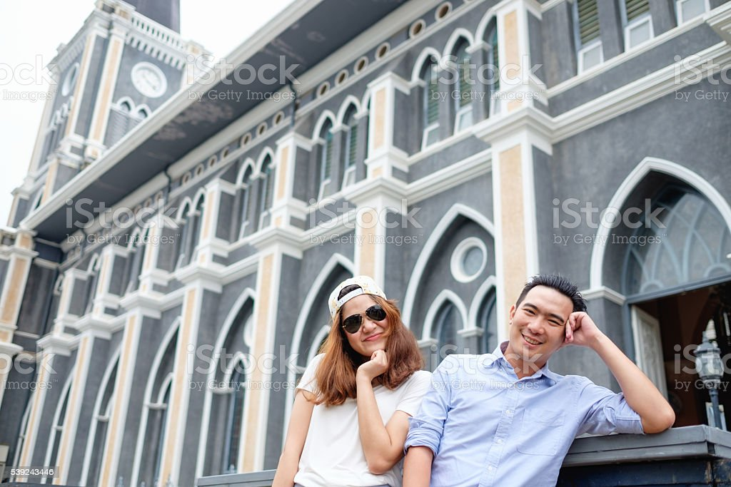 couple at cathedral in  pre wedding stock photo