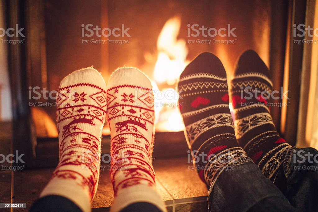 Couple at cozy winter vacation. stock photo