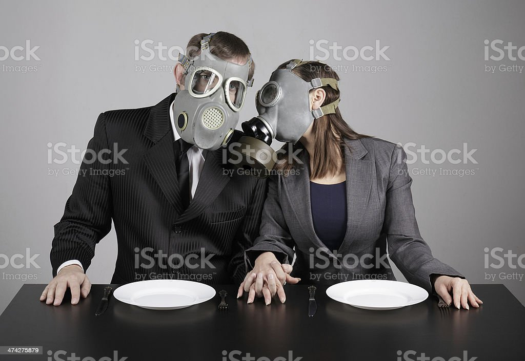 Couple at gas masks stock photo