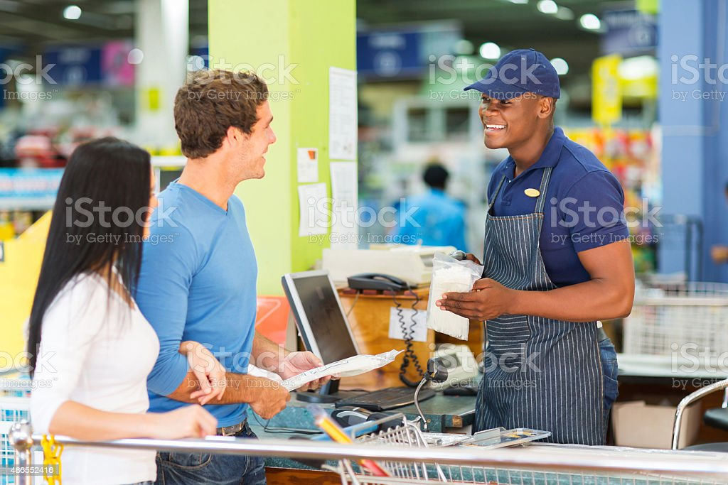 couple at hardware store till point stock photo