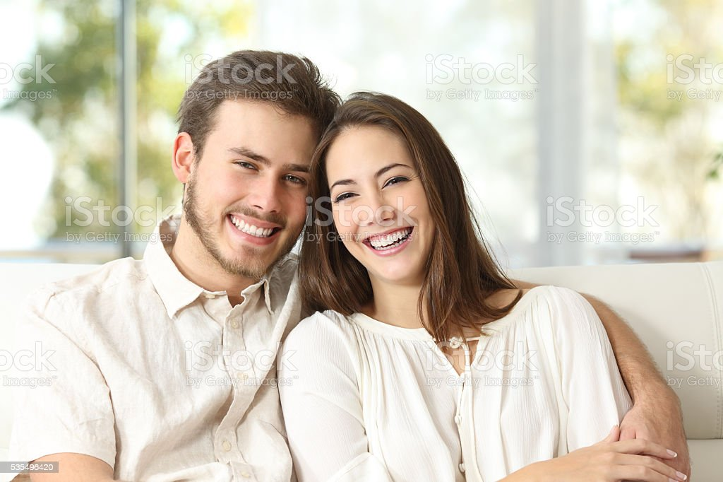 Couple at home looking at camera stock photo