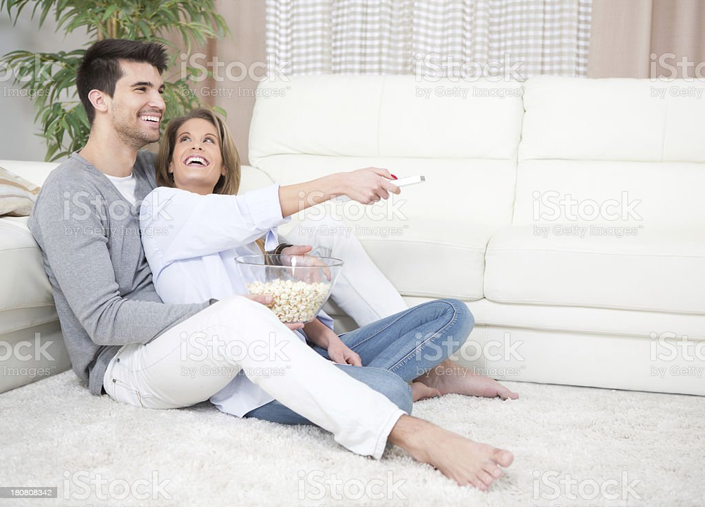 Couple at home watching TV. royalty-free stock photo