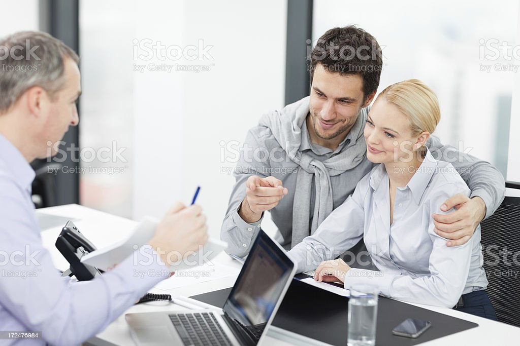 Couple at meeting with financial advisor royalty-free stock photo