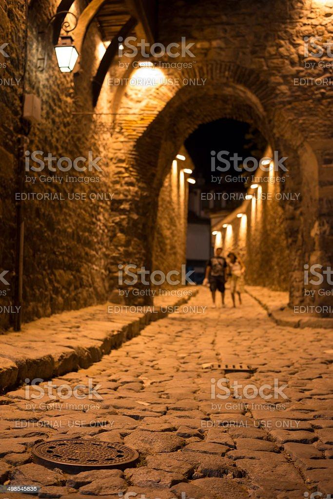 Couple at night walking at Hisar Gate in Plovdiv Bulgaria stock photo