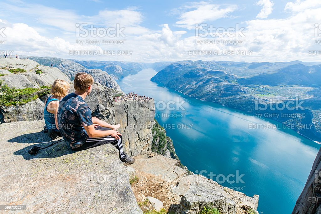 Couple at Pulpit Rock and Lysefjorden stock photo