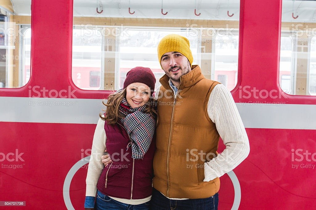 Couple at subway station waiting for train stock photo