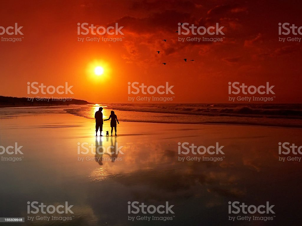 Couple at sunset beach royalty-free stock photo