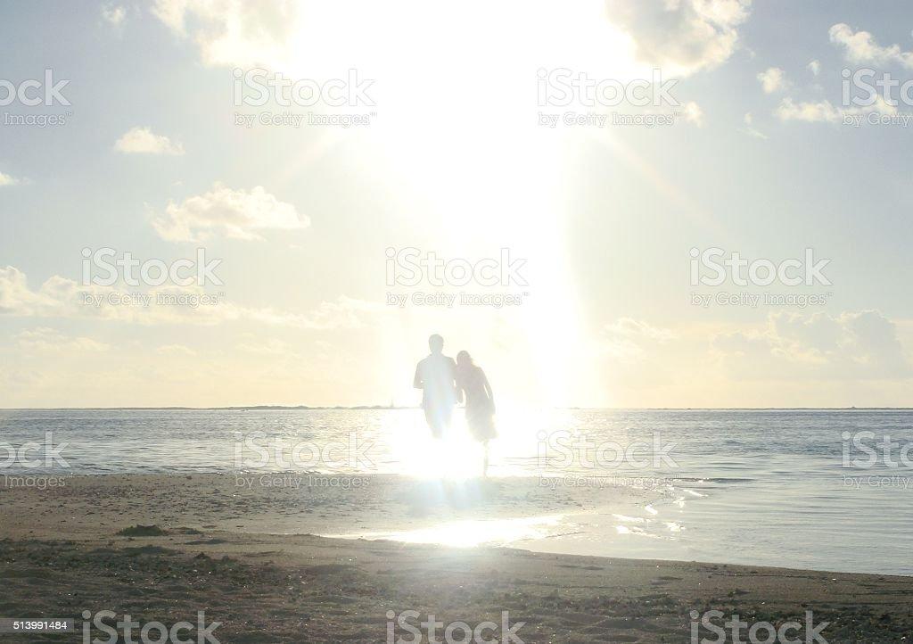 Couple at Sunset in Bora Bora Beach stock photo