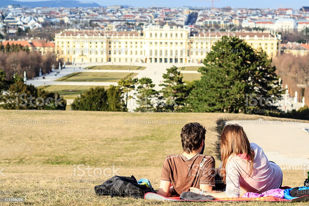Couple at sunset in Schonbrunn, Vienna stock photo