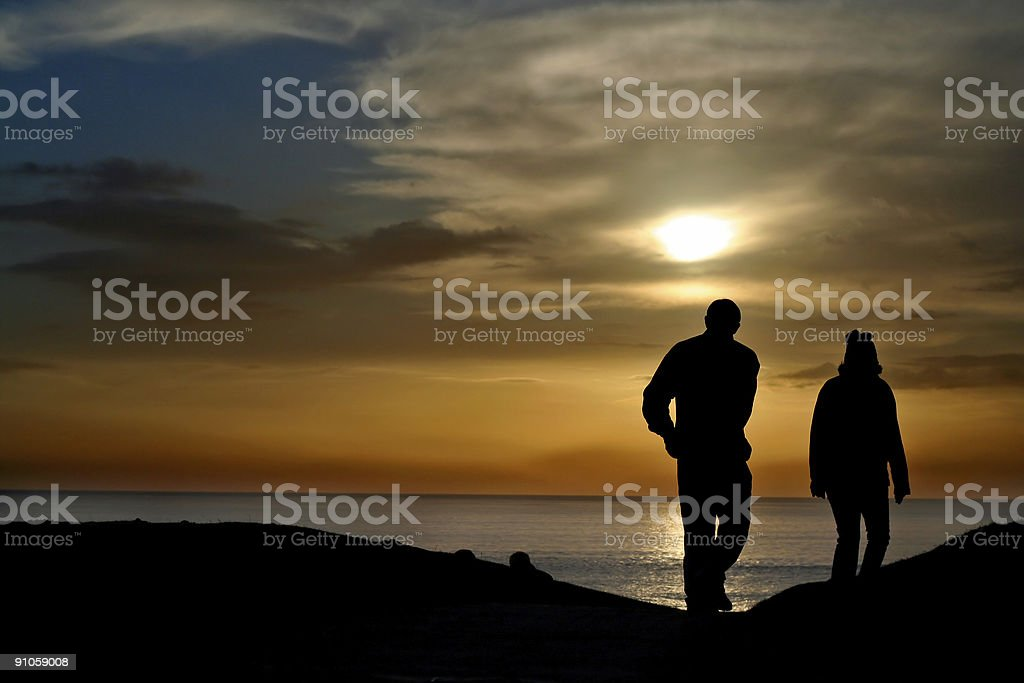 couple at sunset stock photo